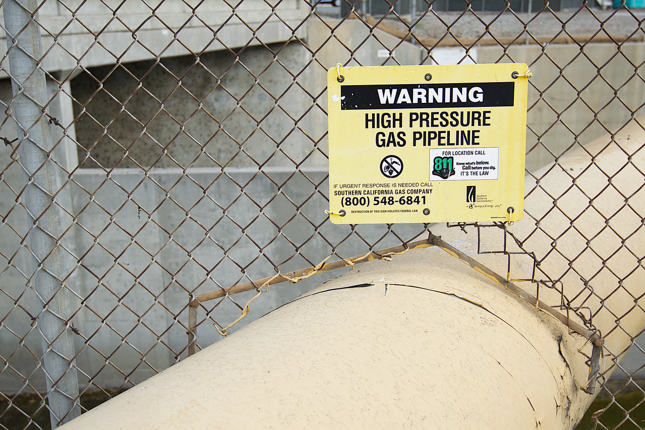 warning sign near gas pipeline
