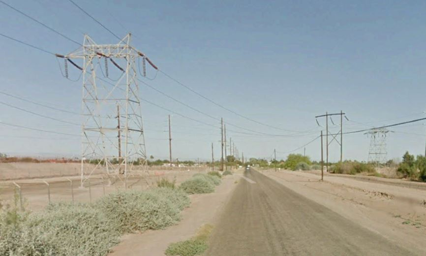 road with electric transmission lines